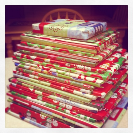 25 books wrapped and stacked