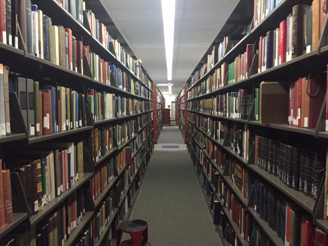 A view down a shelving row of the library.