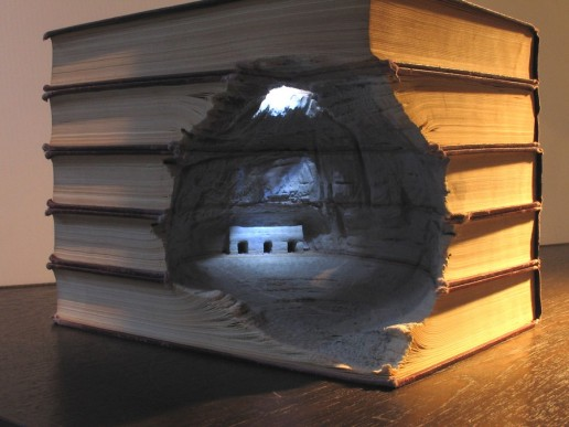 Books cut out to look like a cave